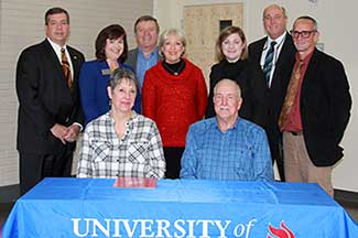 Phyllis and Jim Rogers with UWG officials